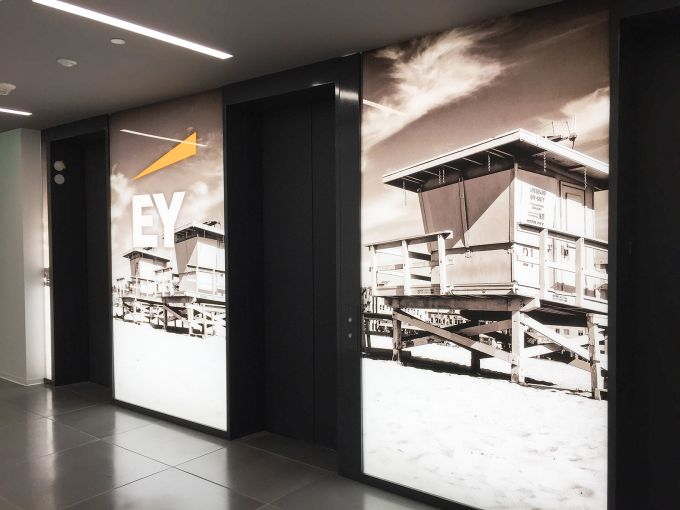 Beachy keen. HOK incorporated iconic L.A. images to EY's offices, including in the elevator lobby area.