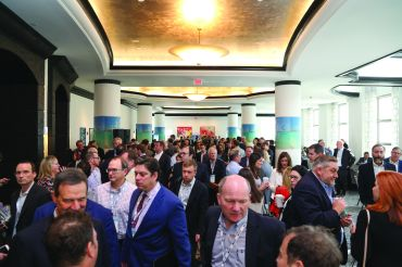 Attendees mingle at CREFC'S Miami 2019 conference.