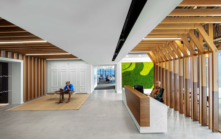 Kantar, which is a subsidiary of GroupM's parent company WPP, got a unique reception area with wood accents and plant walls.