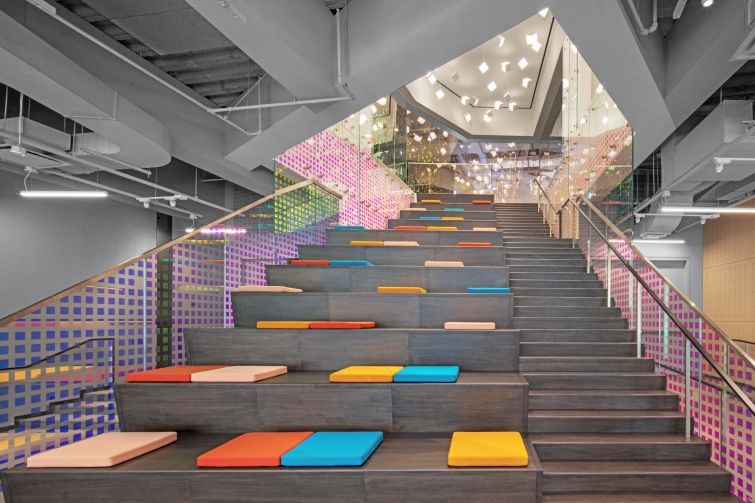 GroupM's new office space at 3 World Trade Center includes a bleacher stair for all-hands meetings.