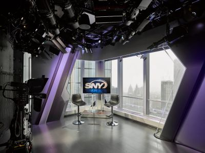 SportsNet New York's new studios in 4 World Trade Center feature floor to ceiling windows and accent lighting.