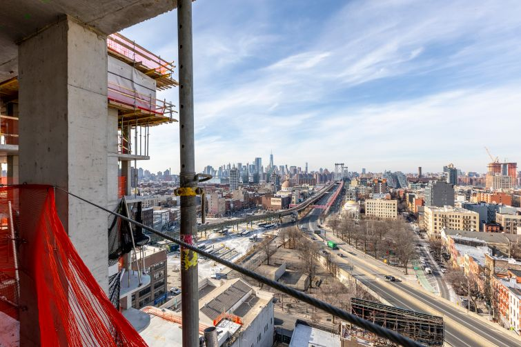 The east-facing view from the 16th floor of the residential tower in the Dime Savings Bank complex features views of the Williamsburg Bridge and neighboring Manhattan.
