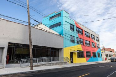 The exterior of The Breeze was painted in bright primary colors in an effort to connect with the surrounding murals and graffiti in East Williamsburg.