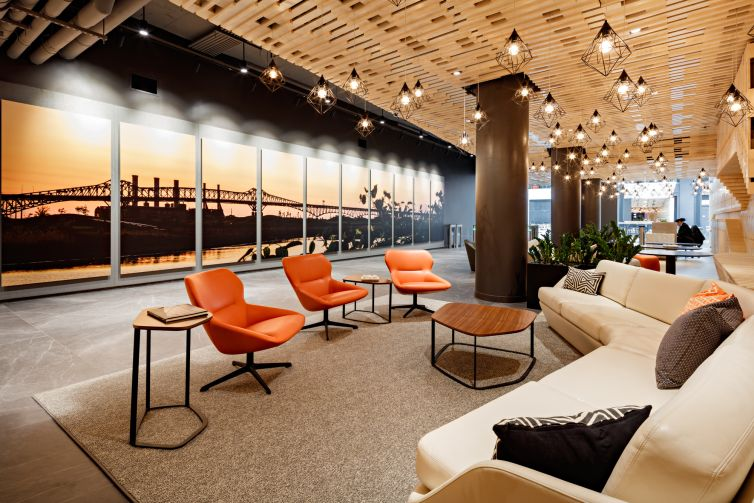 Redesigned Harborside 2 building lobby, featuring a panorama display of the Pulaski Skyway, taken by Jersey City-based photographer Joe Velez