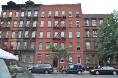 312 East 116th Street, one of the properties co-owned by Amit Doshi and Michael Besen.