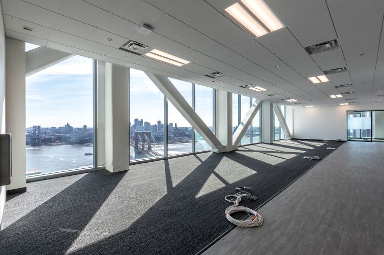 New offices for city agencies like the Department of Sanitation and the Human Resources Administration feature floor-to-ceiling windows.