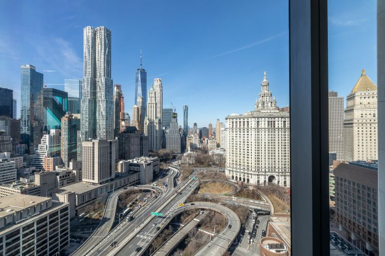 The renovation added floor-to-ceiling windows for office tenants on the top half of the building, offering sweeping views of Downtown and both bridges.