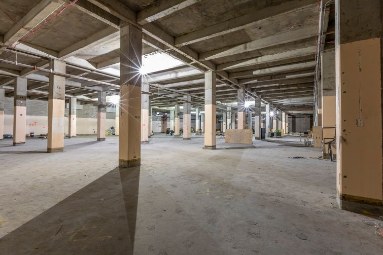 The NYPD will occupy unrenovated floors that still feature the building's old strip windows.