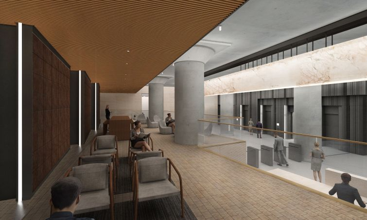 A view of the seating area in the lobby as well as the anodized aluminum elevator surrounds.