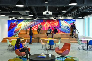 Booking.com designed its new offices with each part of the office following a different New York City theme. The cafeteria features a huge photo of the Nathan's Famous hot dog sign in Coney Island.