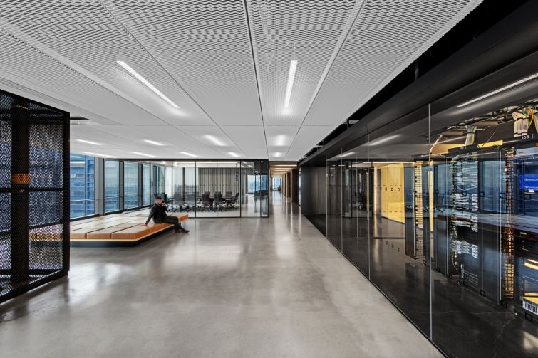 Large open spaces, glassed-in conference and board rooms and polished concrete floors are major features of IEX's space.