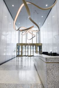 Kaufman Organization renovated the lobby of 450 Seventh Avenue and added a twisty bronze chandelier.