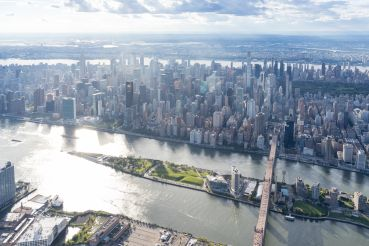 An aerial view of Cornell Tech's campus on Roosevelt Island, which was master-planned by SOM and features a passive house dorm designed by Handel Architects, two firms on our Power Designers list.