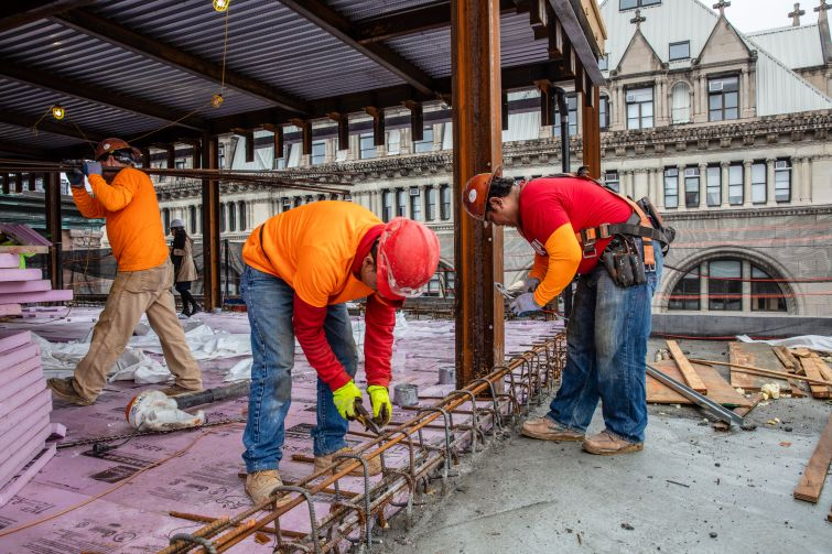 More workers laying the ground work for a new wraparound terrace.