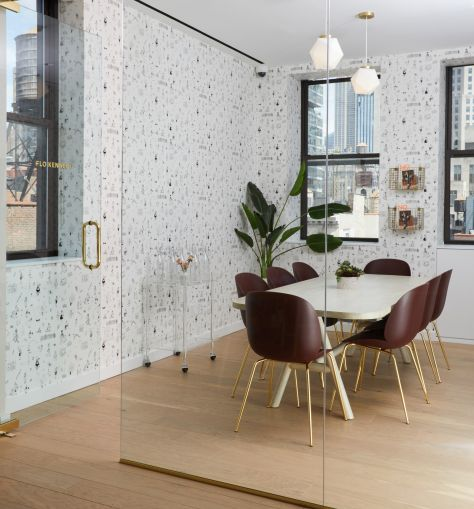 The new conference room features a custom-designed wallpaper with women doing different activities in New York City.