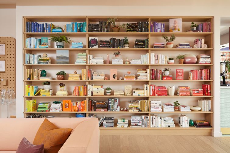 The second lending library is color-coded and has titles by and about women.