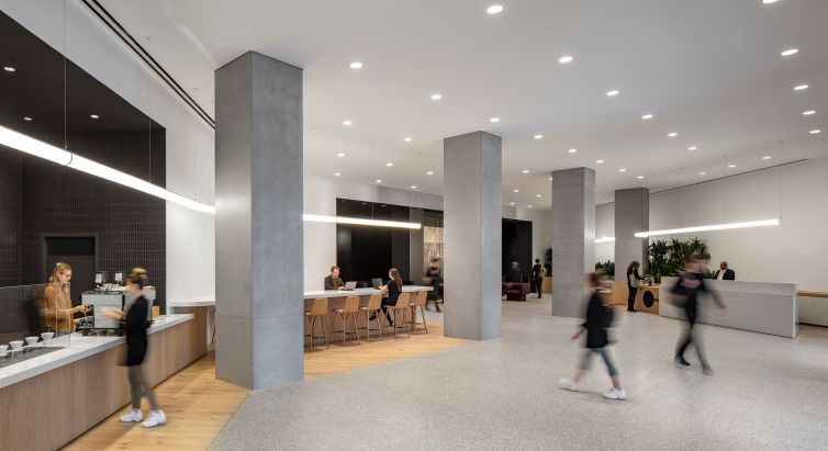 All three renovations included removing drop ceilings, exposing the original concrete columns and removing linoleum to expose concrete floors. For 75 Varick, there was also a new coffee bar run by Blue Bottle.