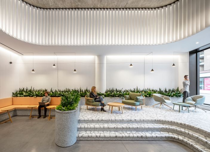 A+I worked on the renovation of three lobbies in former Hudson Square printing press buildings. At 225 Varick, the team added a raised seating area and vertical fins to highlight the 14-foot-tall ceilings.