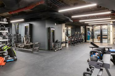 Companies are focused on adding amenities like gyms and nap pods when they should be spending money on lighting and air quality improvements for their employees.