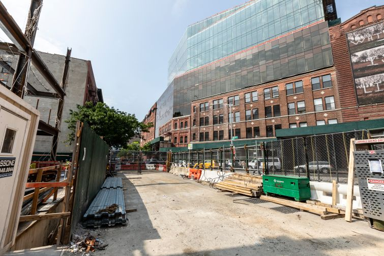 """Across the street from the Taystee Building, Janus is also in the midst of expanding the Malt House, a former brewery, with several stories of new glass office space. Both buildings are part of what Janus has dubbed the """"Manhattanville Factory District."""""""