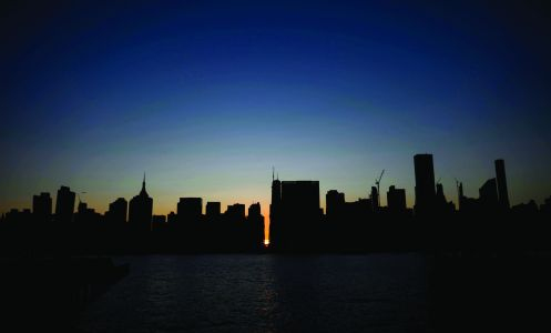 Subway stations plunged into darkness and the billboards of Times Square suddenly flicked off as New York's Manhattan was hit by a power outage on Saturday. About 42,000 customers lost electricity in the early evening, according to Con Ed.
