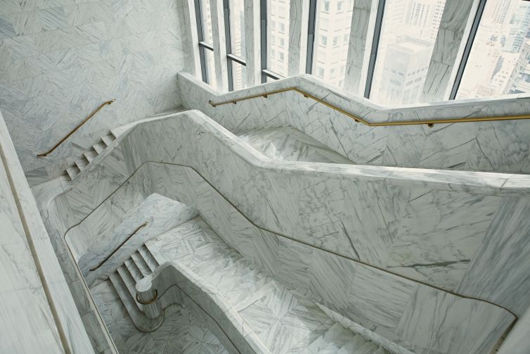The executive floors at 550 Madison have a massive white marble staircase that links all three floors.