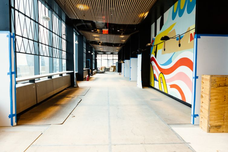 The walls of the lobby have been painted with murals from local artists celebrating the Navy Yard's history.