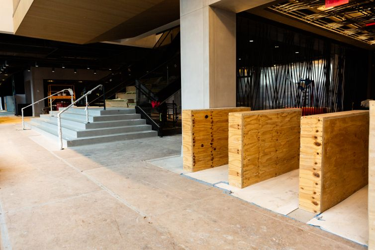 A large main stair in the lobby attempts to instill a community vibe into the building, which will be anchored by WeWork.