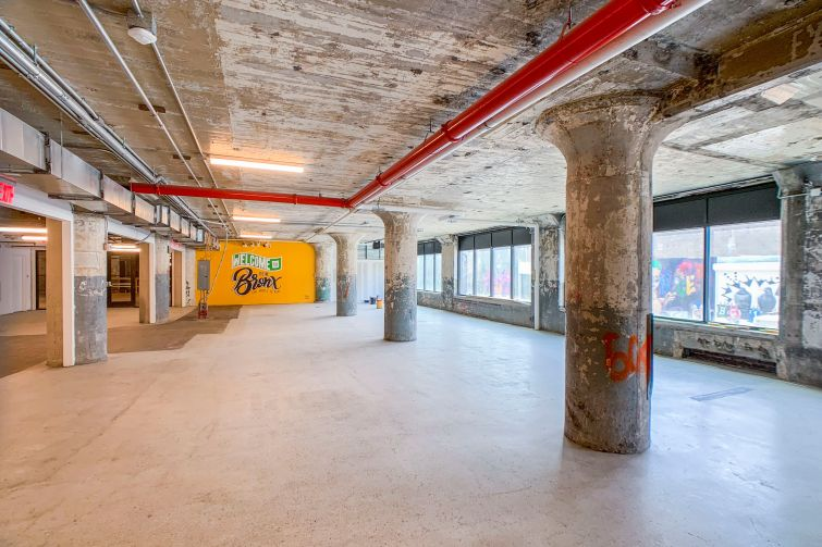 Union Crossing, former warehouse in the South Bronx, has been renovated with new mechanicals, new elevators, new bathrooms and a new lobby that includes a bright mural.
