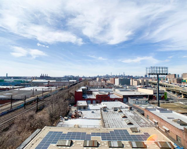 Views from the roof of Union Crossing, which faces elevated freight tracks and the Bruckner Expressway.