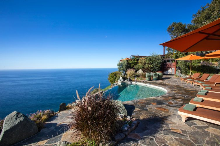 An infinity edge pool and the view from the resort.