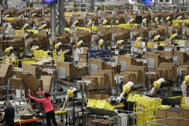 Humans and machines at work at an Amazon Fulfillment center.