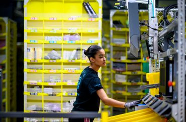 A woman at work in a logistics center.