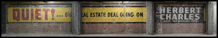 A full view of the vintage real estate ad, which was originally painted on the exterior of the building next door.