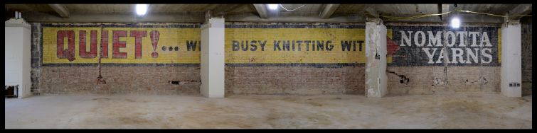 "The sign uncovered on the fifth floor reads, ""QUIET! We're busy knitting with Nomotta Yarns."""