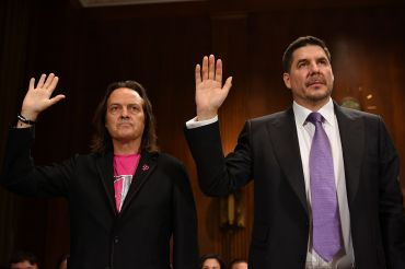 T-Mobile CEO John Legere (Ieft) and SoftBank Group and Sprint's Marcelo Claure. Legere is reportedly in talks to take over as CEO of WeWork.