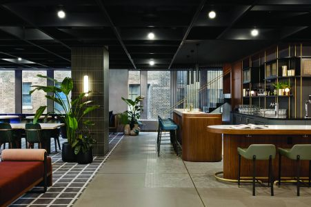 Fogarty Finger Architecture designed a mid-century modern lounge at 1700 Broadway that includes a classic wooden bar.