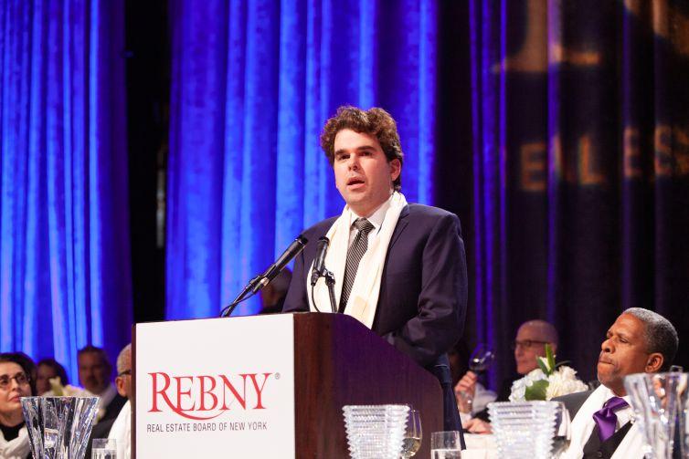 Jay Kriegel's son, Connor, accepts the John E. Zuccotti Public Service Award on his behalf.