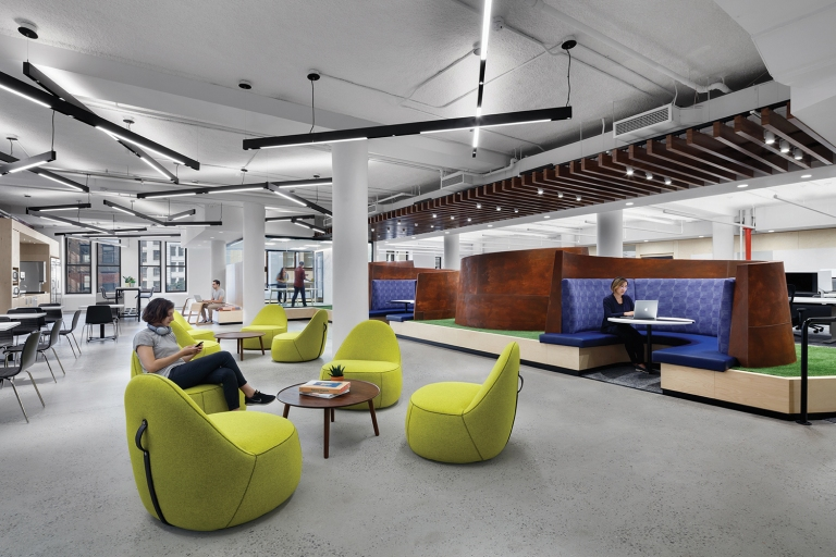 Richard Serra-inspired booths create an artistic feel in a lounge designed for Capital One's tech team.