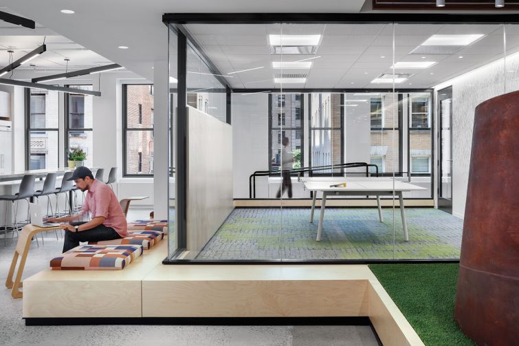 An elevated AstroTurf floor in the lounge is meant to be reminiscent of nearby Madison Square Park.