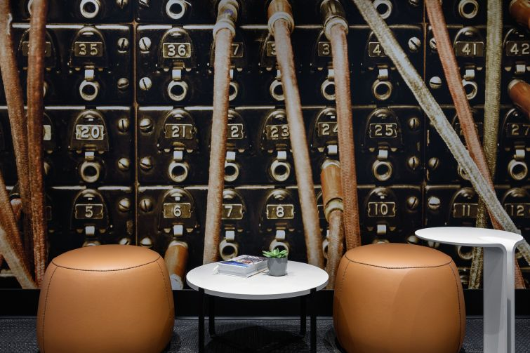 Sitting rooms were designed around the idea of old technology, like telephone switchboards.