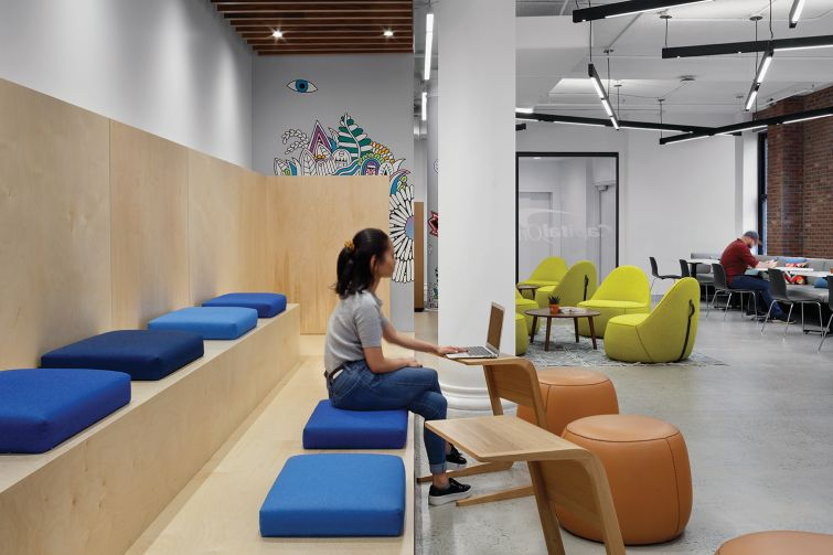One lounge is designed with plywood bleachers for all hands meetings.