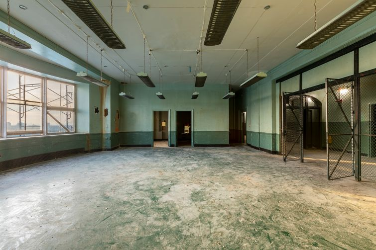 On the ninth floor, an auditorium with a stage and projection room, where visiting thespians would put on plays for sick patients, will be restored with a plaster ceiling and a rounded wood proscenium.