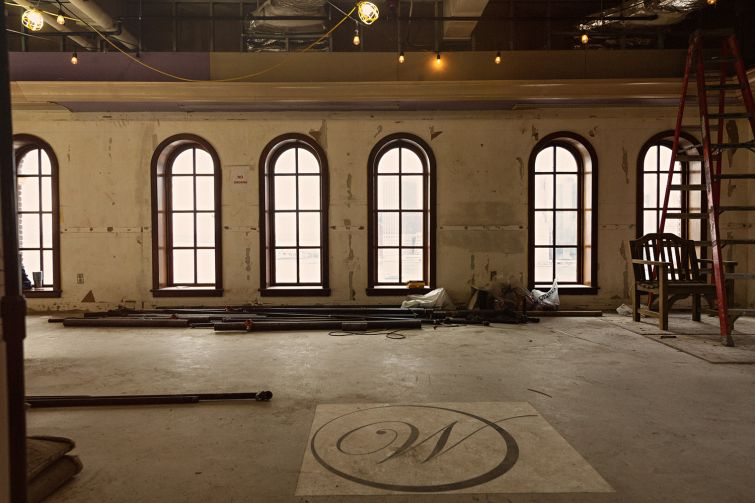 Original window shapes were kept throughout the building, including these distinctive round windows on the 16th floor.