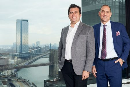 Former Skanska CEO and President Rich Cavallaro, right, is replacing Bill Gilbane III, left, as the executive in charge of Gilbane's New York division.