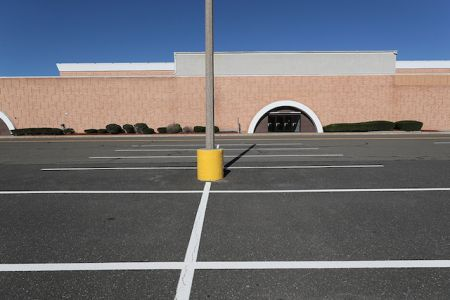 An empty parking lot at the Enfield Square Mall in Enfield, Conn.