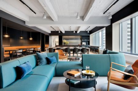 Rockefeller Group's new offices, designed by Fogarty Finger, include a 3,000-square-foot common area with mid-century modern furniture, exposed concrete ceiling and a pantry.