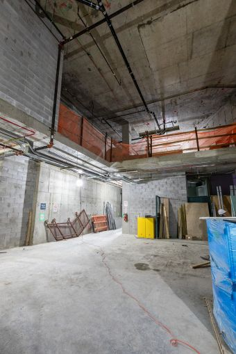 The third floor of commerical space at 25 Park Row features tall ceilings that open to a mezzanine level.
