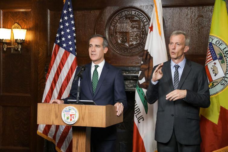 Mayor Eric Garcetti, left, addresses the coronavirus outbreak in a video announcement.
