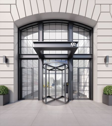 The renovation included a new double-height glass entrance with revolving doors.